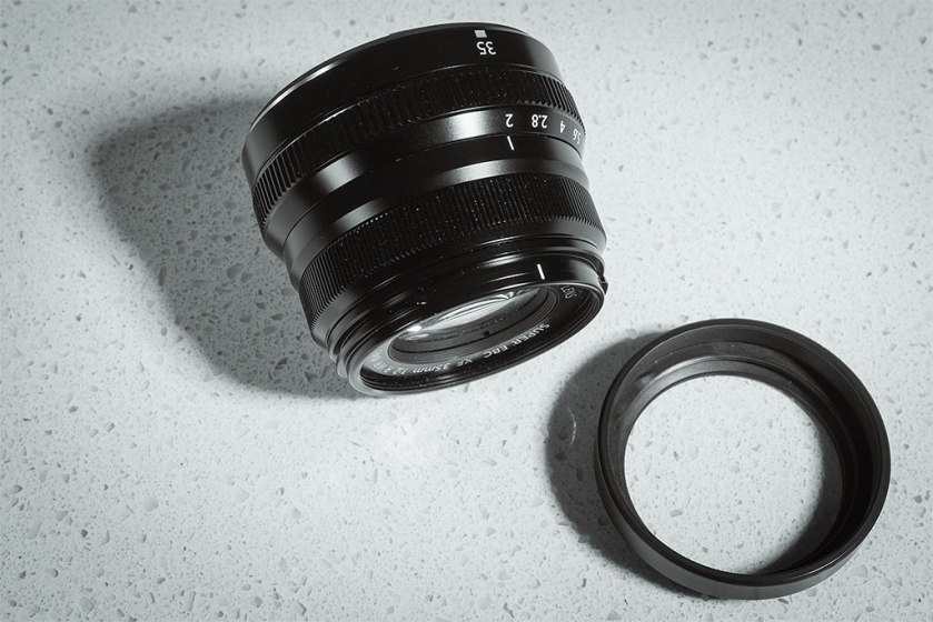 The Fujinon XF 35mm f2 prime lens with supplied plastic lens hood which tends to bind or become loose and drop off. I recommend the optional metal Leica-style vented lens hood.