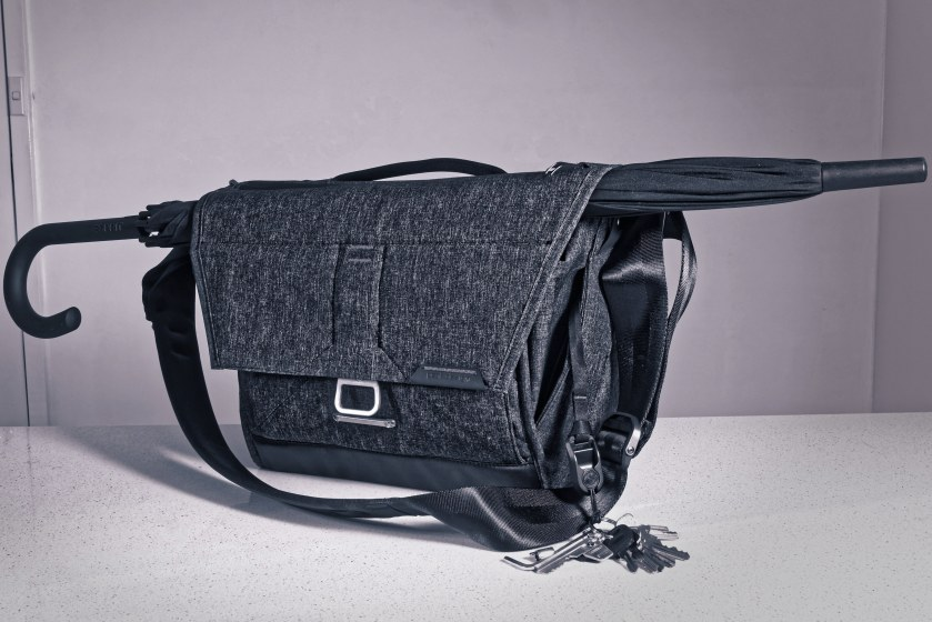 Peak Design's Everyday Messenger 13 may be based on cycle messenger's bags but its execution also has some of the flavour of a laptop-toting attaché case, making the bag go well with the tightly furled umbrellas seen in the City of London. The EDM13 blends looks with utility, illustrated here by its Anchor Link tether strap and pocket for keys.