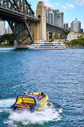 Jet boat heading for one of the many cruise liners that arrive in Sydney Harbour throughout the year.