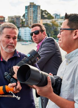 Australian X-Photographer Andrew Hall has been using Fujifilm's longer Fujinon zoom lenses with his X-T1 and more recently X-T2 cameras for motorsports photography in races around the world. I found Andrew discussing and comparing big, long lenses on the balcony outside the event venue in Luna Park.