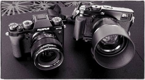 Fujifilm's two latest pro-quality cameras, the X-T2 and a rigged-up X-Pro2. Smartphone photograph by Carmel Duryea, processed with Macphun Tonality CK. .