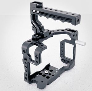 Loosen the two screws in the top of the Classic Plus Handle to slide the handle's top rail for better balance once you have placed your GH5 into the cage.