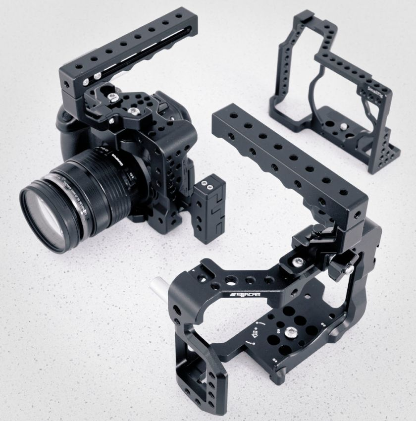 Motion9 GH4 cage at left, Seercam GH5 cage at front and SmallRig GX8 cage at rear right.