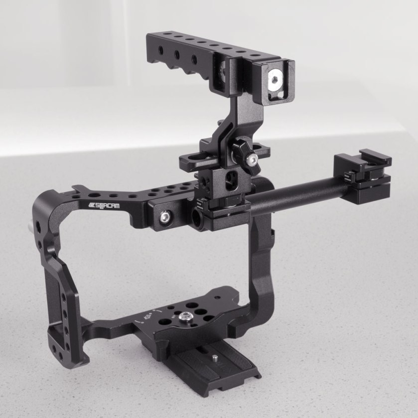 Seercam Cube GH5 camera cage for the Panasonic Lumix GH5 with Extension Kit for Cube GH5, cold shoes attached to the Classic Plus quick-release handle and a tripod plate beneath.