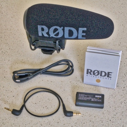 The contents – the Røde VideoMic Pro+ itself, Quickstart Guide, Micro USB cable, LB-1 Lithium Ion Rechargeable Battery and 3.5mm TRS Output Cable.