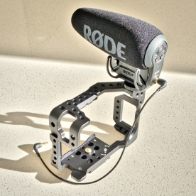 "The Røde VideoMic Pro+ mounted on a Seercam Cube GH5 camera cage. This cage comes with two built-in coldshoes and extra coldshoes can be attached to 1/4""-20 threaded mounting holes all over it."