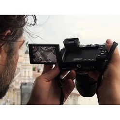 Australian photojournalist Daniel Berehulak using his Panasonic Lumix DMC-GX8 with fully-articulated LCD monitor.